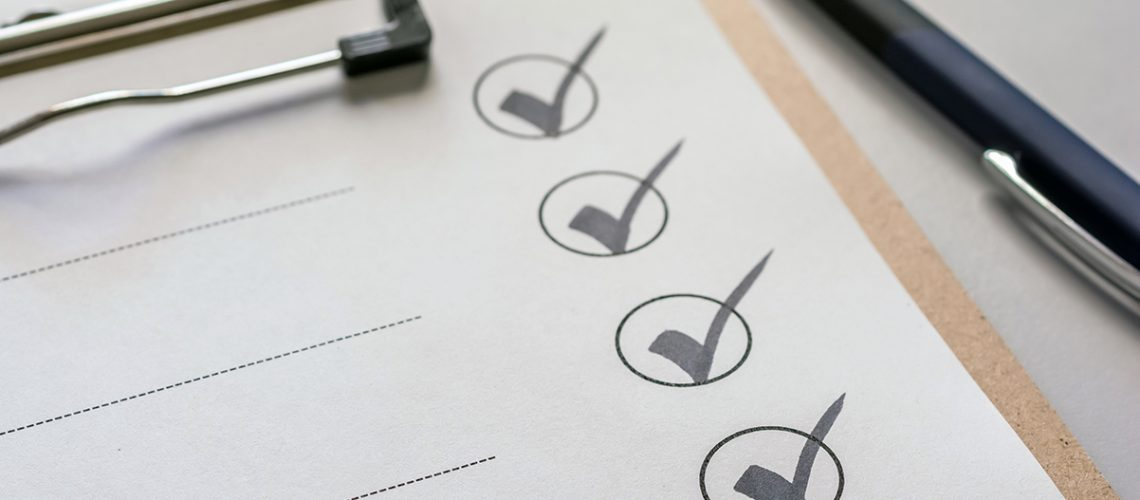 Checkmarks on a paper clipped to a clipboard